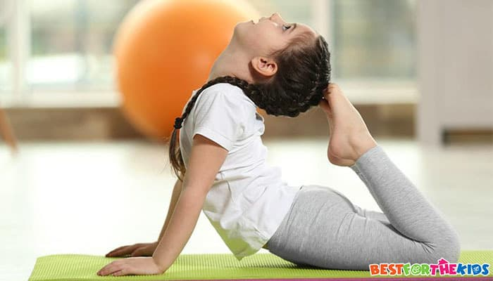 kid practising yoga